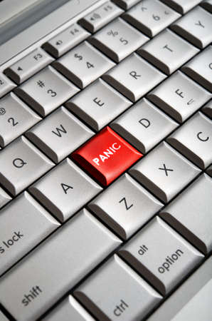 Close-up image of a red panic button on a traditional computer keyboard Stock Photo - 4982826