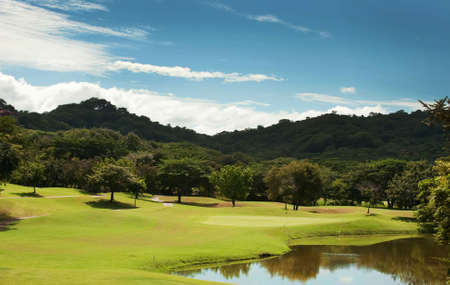 Image of a beautiful golf course fairway at a tropical resort photo