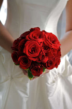 red rose bouquet in bride's hands Stock Photo