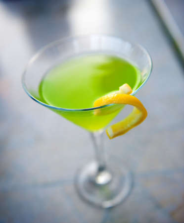 Image of a lime green cocktail in a martini glass photo