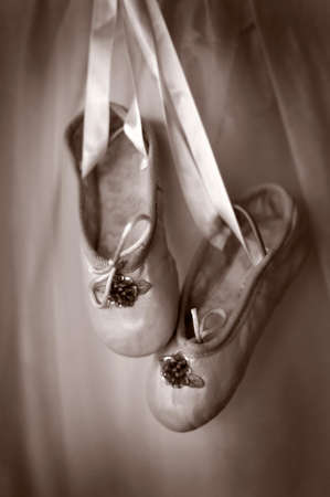 Image of dance or ballet slippers in sepia tone