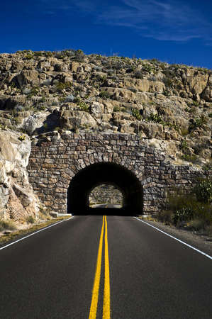 road tunnel: Image of a highway heading into a tunnel Stock Photo