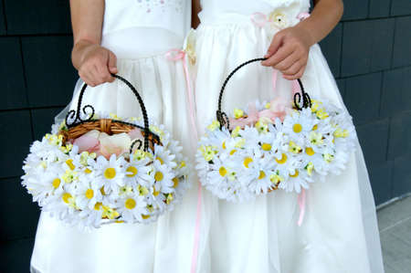 Image of two flower girls holding daisy baskets