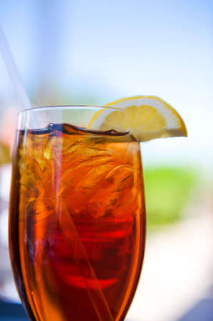 Image of a cold glass of iced tea with lemon