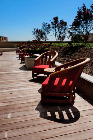 patio chairs: Image of several wooden patio chairs on a deck