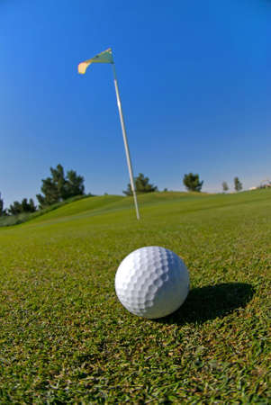 Image of a golf ball on green photo