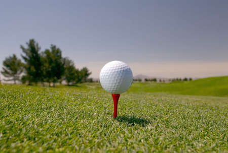 Image of a white golf ball on a red tee
