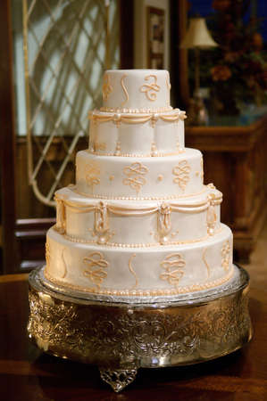 Classic wedding cake with gold icing photo
