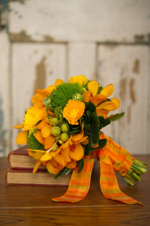 Image of a beautiful floral bouquet on stack of books