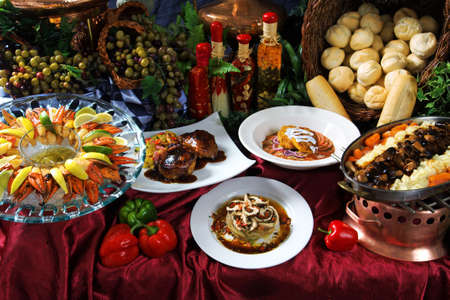 Image of a feast of different foods on a decorative table