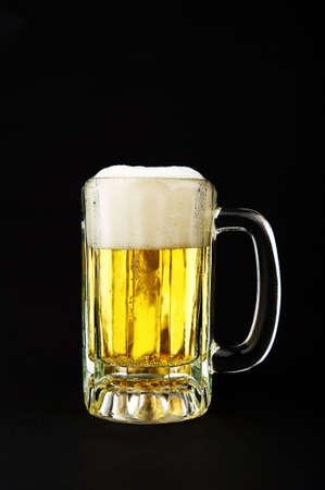 Image of a mug of beer on black background photo