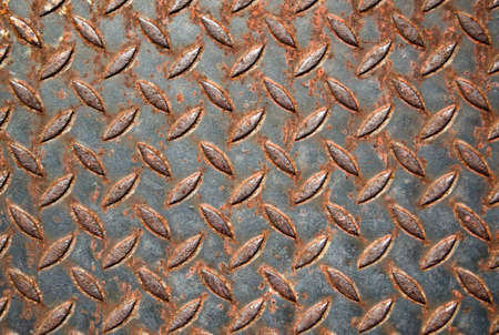 Closeup image of rusty treadplate, ideal for background photo