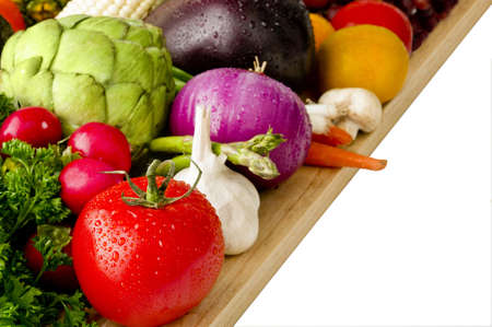 cutting vegetables: Image of various vegetables on a cutting board Stock Photo
