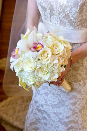 image of a wedding bouquet being held in brides hands photo