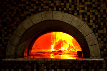 stove: Image detail of a wood fired pizza oven with fire blazing