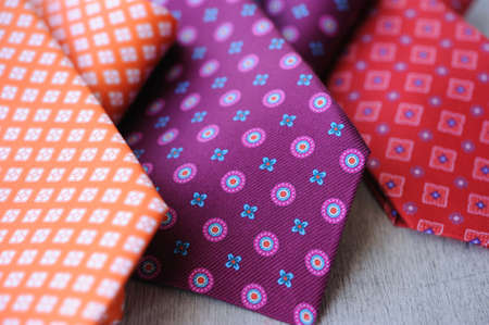 working stiff: Image of 3 ties on white wood background