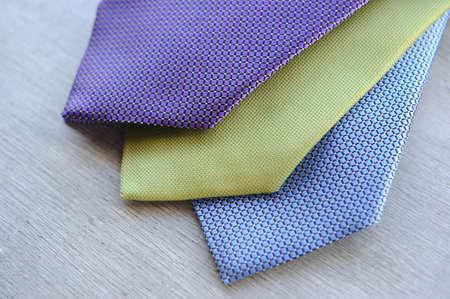 ironed: Image of 3 ties on white wood background