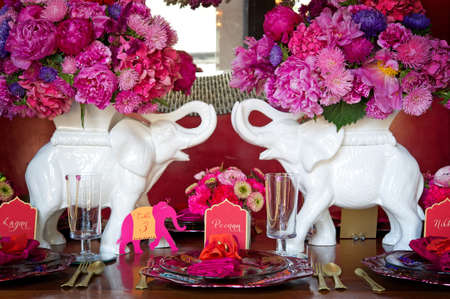 flower arrangement: Image of a place setting for Indian wedding