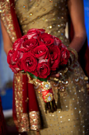 Image of a beautiful Indian brides bouquet during wedding photo