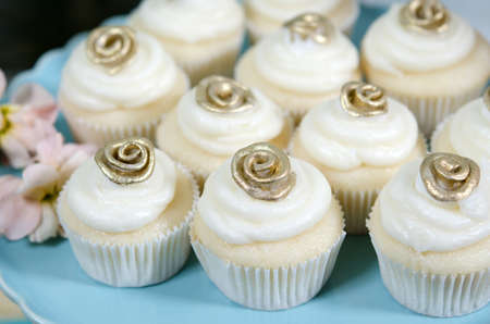 Image of beautifully decorated wedding cupcakes on a plate photo