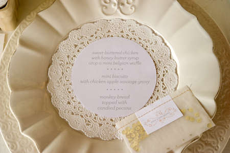 Image of the dinner menu on a plate at wedding reception photo
