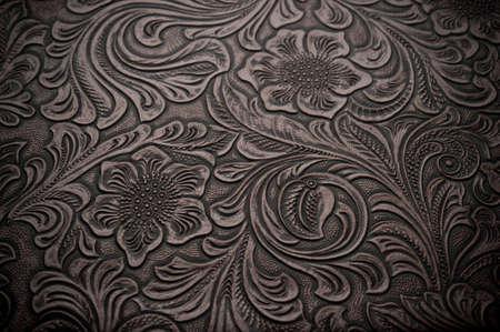Afbeelding van donker bruin bloemdessin gegraveerd leer Stockfoto