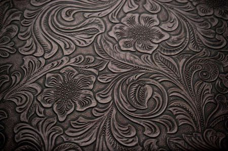 leather background: Image of dark brown floral design engraved leather Stock Photo
