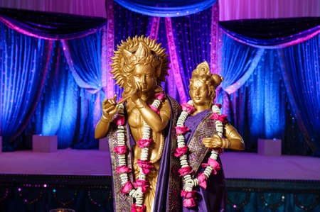 tradition: Image of Hindu Deities in front of mandap at Indian wedding