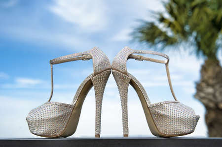Image of fashionable wedding shoes in outdoor setting photo