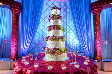 Image of a tall tiered wedding cake at Indian wedding photo
