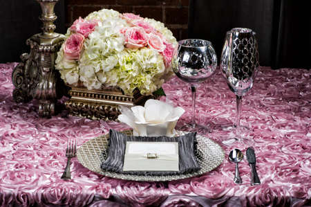 a place setting at a wedding on pink photo