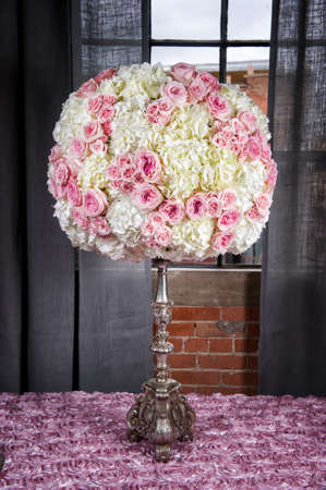 a floral arrangement to be used at a wedding photo
