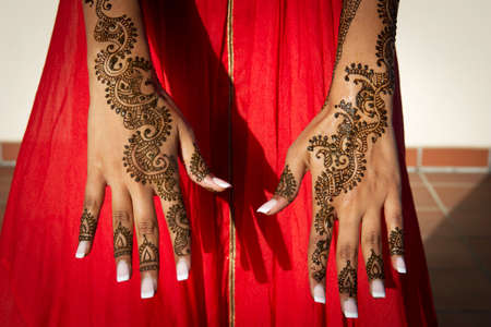 Image of Henna Tattoos on an Indian brides hands photo