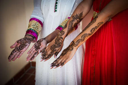 Henna Tattoos on an Indian brides hands photo