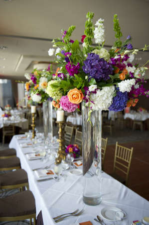 head table at a wedding with floral photo