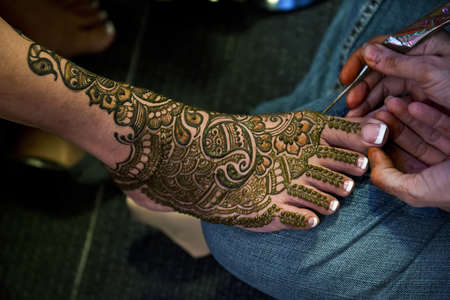Henna Tattoos on an Indian brides feet photo