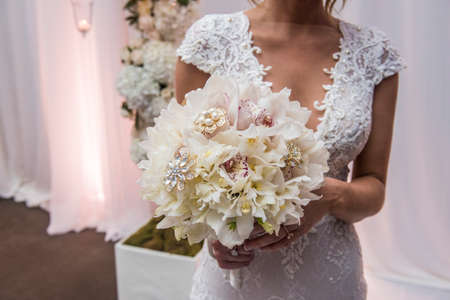 Image closeup of bride holding a beautiful bouquet