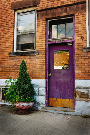apartment building: An image of a unique, colorful and purple doorway