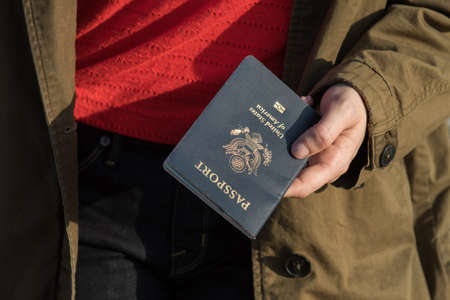 Woman holding passport in hand ready to travel