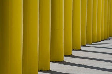 yellow poles with shadows Stok Fotoğraf