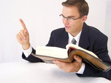Young man studying the Bible Stock Photo