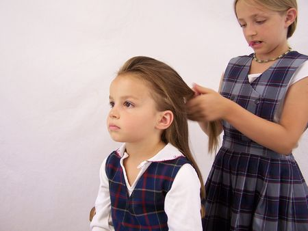 Two girls getting ready for school
