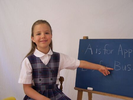 Girl pointing to chalkboard