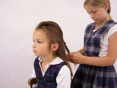 Girls getting ready for school