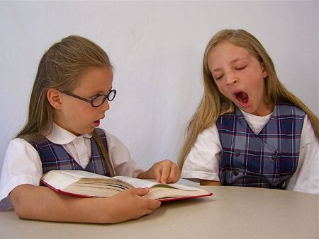 yawning: Girl reading to her sister