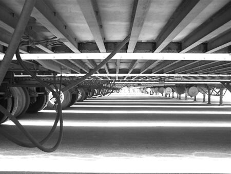 View under trailers, black &white.