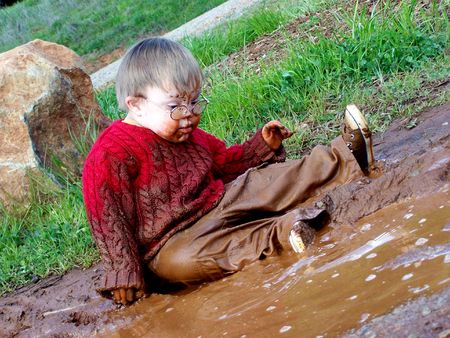 Boy playing in mud Stock Photo - 3407637