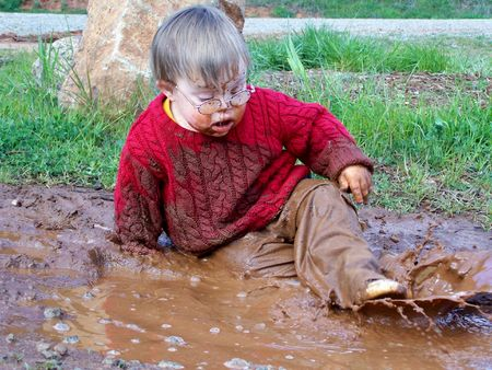 dirty blond: Boy playing in mud