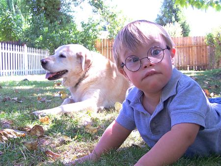 Young boy with dog photo