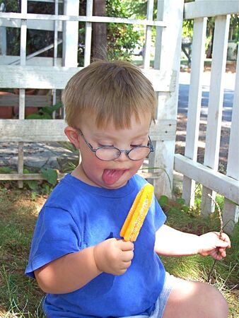 Little boy with ice pop